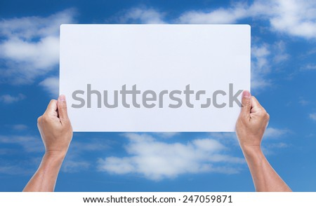 hands holding blank cardboard with blue sky background - stock photo