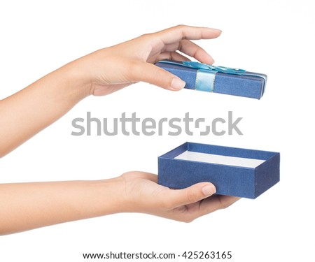 hands holding blue gift box isolated on white background