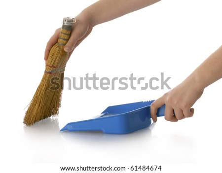 hands holding broom and dust pan sweeping up with reflection on white background - stock photo