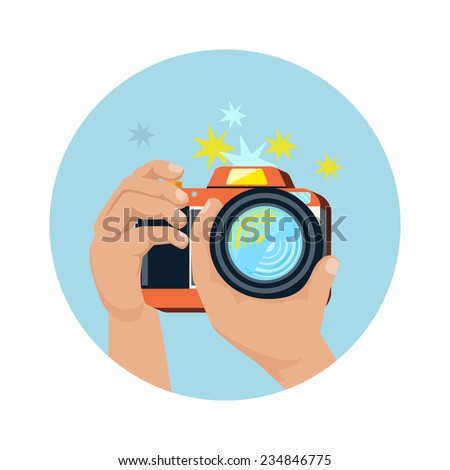 Hands holding camera and photographing in flat design. Raster version - stock photo