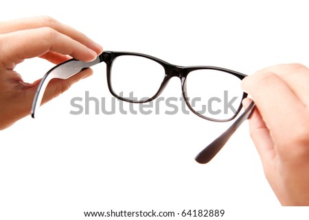 Hands holding classic-styled glasses, isolated on white - stock photo