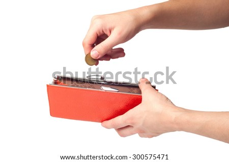 Hands holding coin and orange wallet, isolated on white backgrou - stock photo