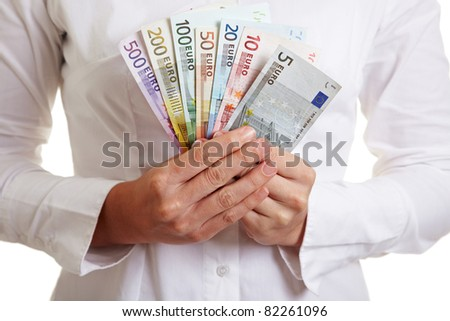 Hands holding colorful fan made of Euro money banknotes - stock photo