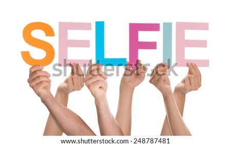 Hands Holding Colorful Letters To Form Selfie Over White Background - stock photo