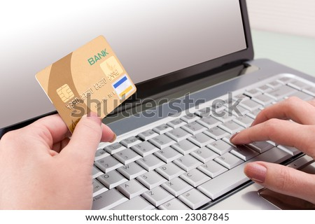 hands holding credit card - stock photo