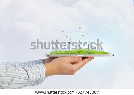 Hands holding digital tablet with energy concept
