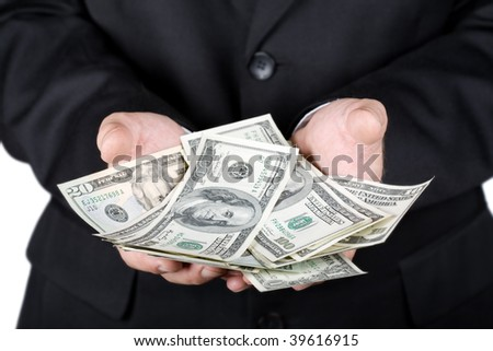 Hands holding dollars isolated on white - stock photo