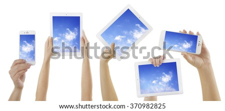 Hands holding electronic gadgets with sky on screens, isolated on white. Cloud computing concept - stock photo
