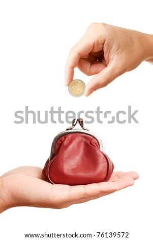 Hands holding euro coin and retro styled money pouch, isolated on white background - stock photo