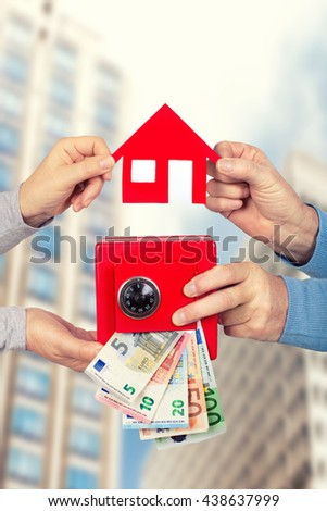 hands holding Euro money in red safe and paper home - stock photo