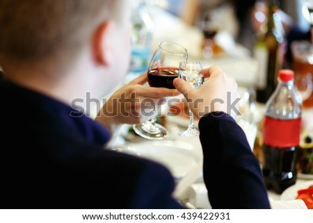 hands holding glasses and toasting, happy festive moment, luxury celebration concept