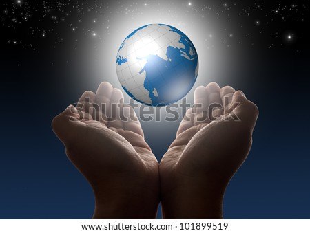 Hands holding glowing digital globe with stars and night sky - stock photo