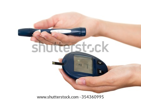 Hands holding glucose meter scanner pen and measure monitor in other hand with white background.