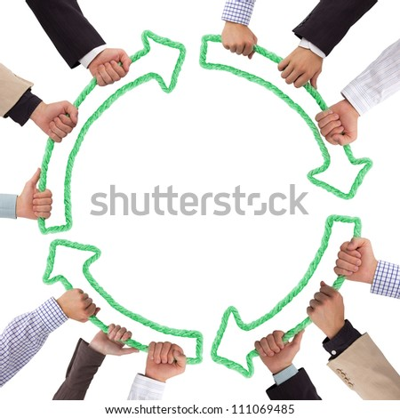 Hands holding green arrows - stock photo