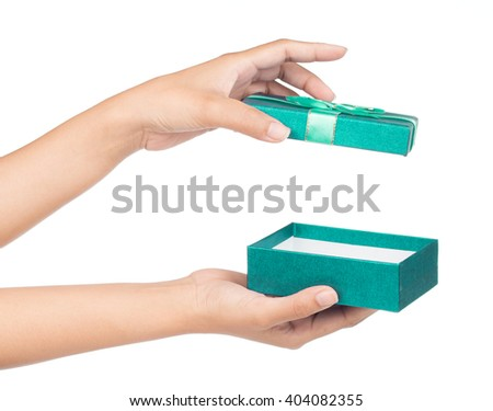 hands holding green gift box isolated on white background - stock photo