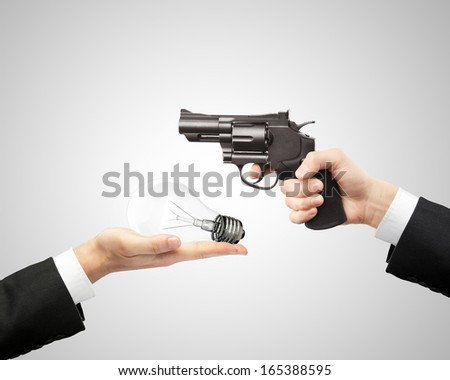 hands holding gun and bulb