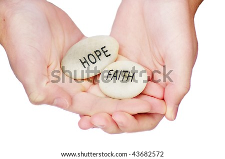 Hands holding hope and faith rocks - stock photo