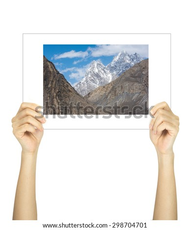 Hands holding landscape of pakistan picture isolated on white  - stock photo