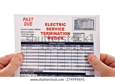 Hands Holding Late Electricity Service Past Due Bill On White Background - stock photo