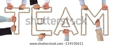 Hands holding letters forming Team tag
