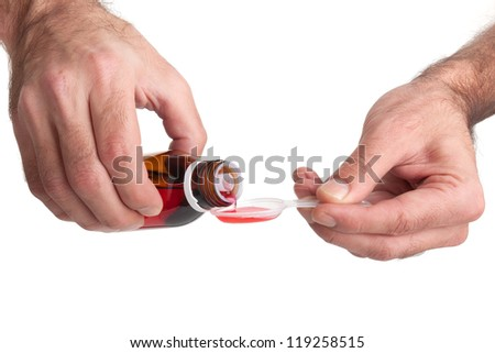 Hands holding medicine health care syrup - stock photo
