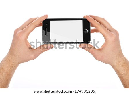 Hands  holding mobile smart phone with blank screen. Isolated on white background.