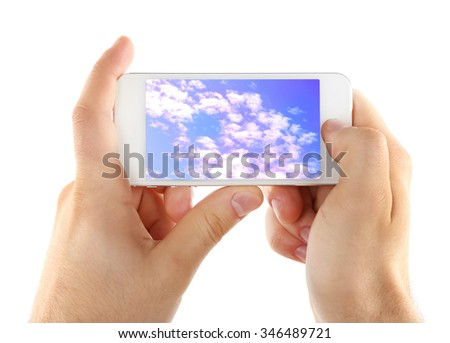 Hands holding mobile smart phone with sky in screen. Cloud computing concept - stock photo