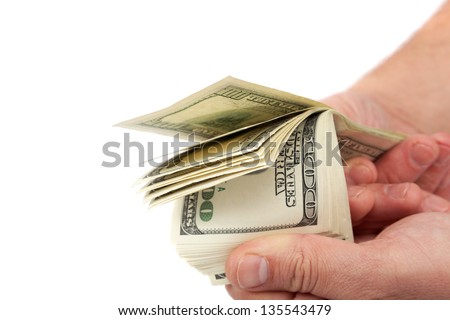 Hands holding money dollars isolated on white background. - stock photo