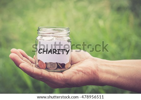 Hands holding money in the jar save money for investment concept. filter effect retro vintage style