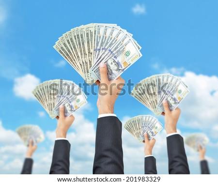 Hands holding money - United States dollar (USD) banknotes - money raising, funding & consumerism concept - stock photo