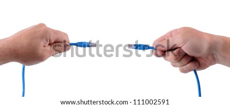 hands holding network cables connecting symbol of connection - stock photo