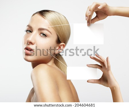 hands holding notes about skin and face - stock photo