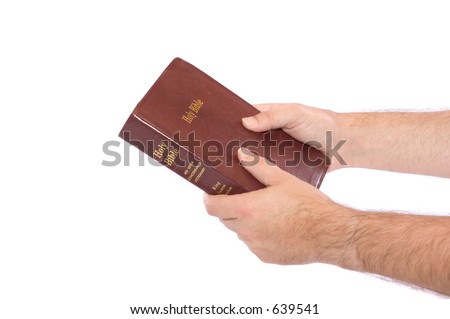 Hands holding onto Bible