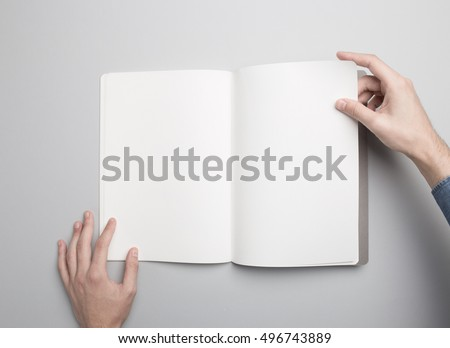 Hands holding opened Notebook. Blank paper Mock-up.