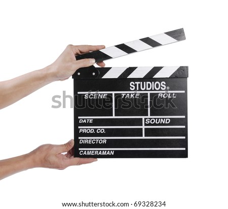 Hands holding out a clapper board - stock photo