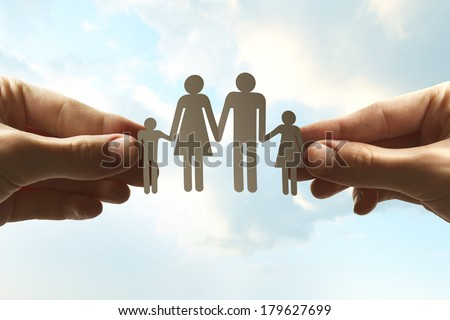 Hands holding paper family concept - stock photo