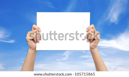 Hands holding paper over the sky - stock photo