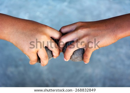 hands holding petanque balls - stock photo
