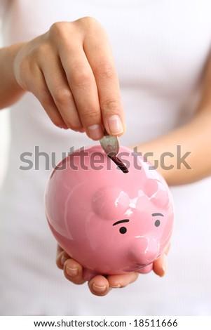 Hands holding piggy bank - stock photo