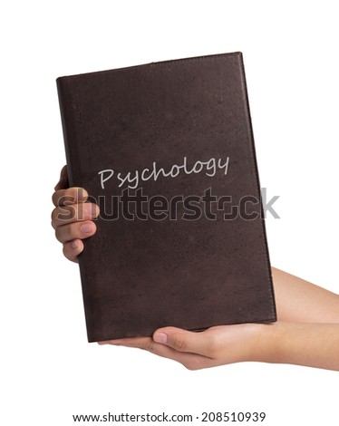Hands holding Psychology book - stock photo