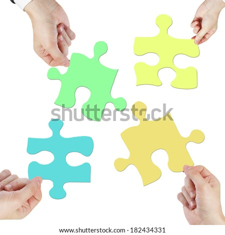 hands holding puzzle isolated on white - stock photo