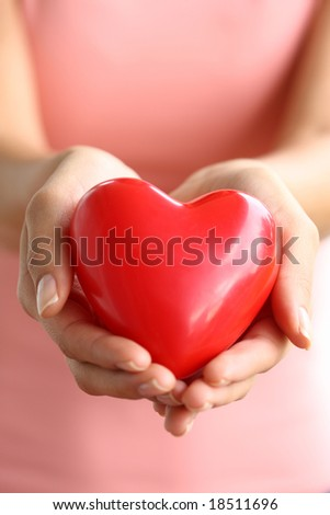 Hands holding red heart - stock photo