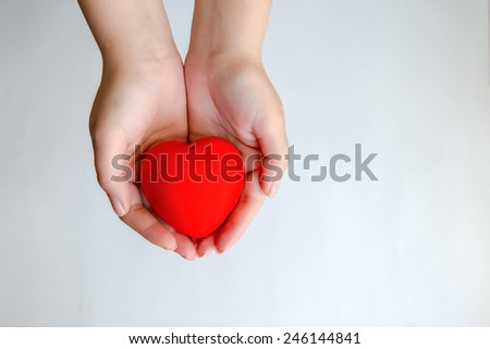 Hands holding red heart isolated - stock photo