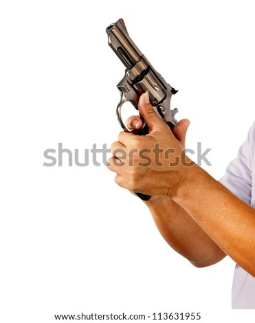 hands holding revolver gun in ready to fire manner - stock photo