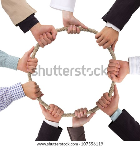 Hands holding rope forming a circle with white space for text - stock photo