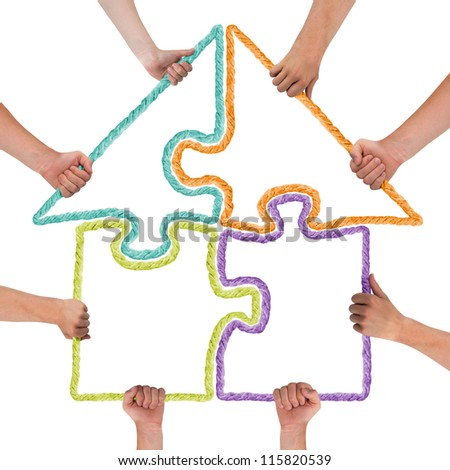 Hands holding rope forming puzzle - stock photo