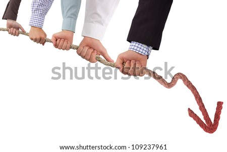 Hands holding rope with red arrow, concept of crisis - stock photo