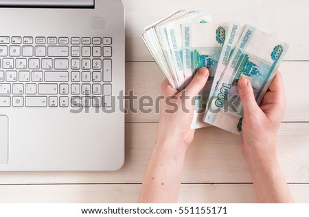 Hands Holding Russian Rubles Near Laptop Stock Photo Royalty Free