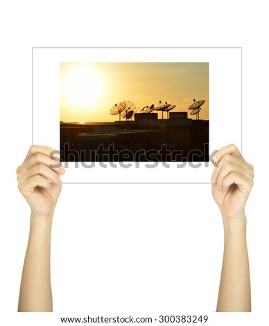 Hands holding sattlelite picture isolated on white  - stock photo
