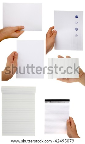 Hands holding sheets of paper isolated with clipping path - stock photo